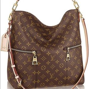 Louis Vuitton Millie monogrammed bag NEW CONDITION